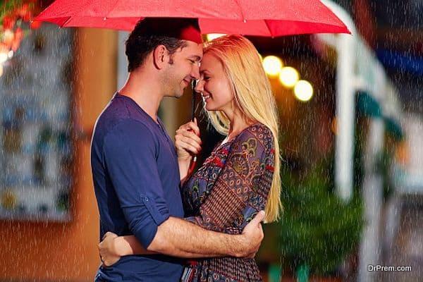 romantic couple under the rain on evening street