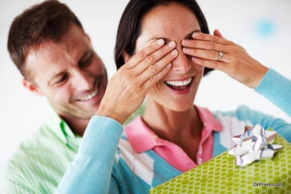 Man Giving Woman Surprise Gift