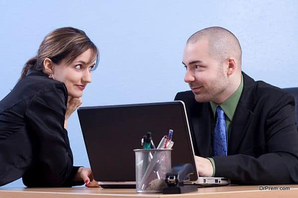 Young Couple Flirting in a Business Office