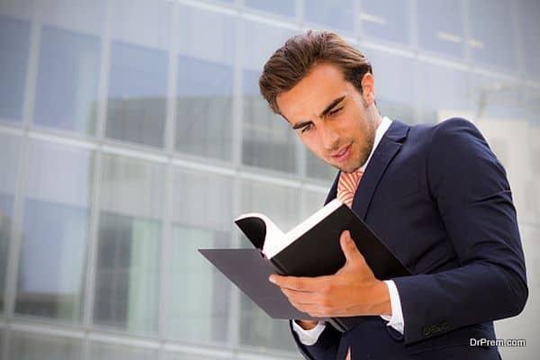 Young Entrepreneur reading book