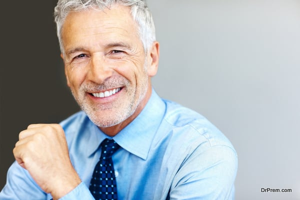 Successful mature business man smiling - Copyspace