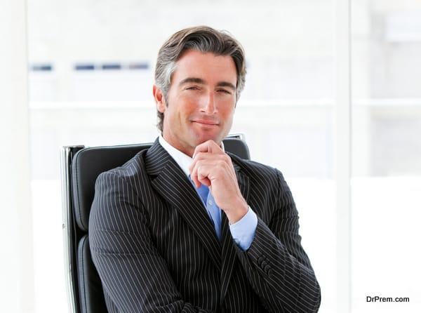 Ambitious male executive sitting in his office in a company