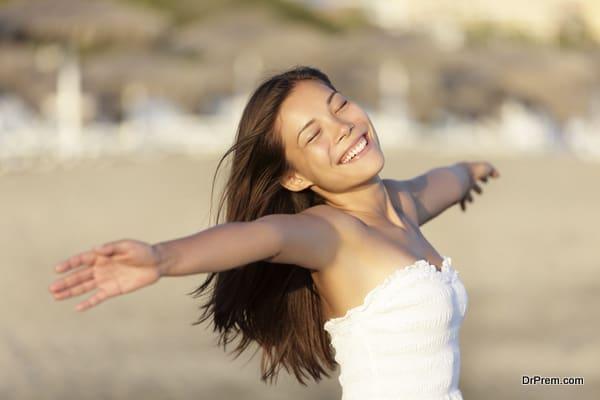Carefree beach woman happy