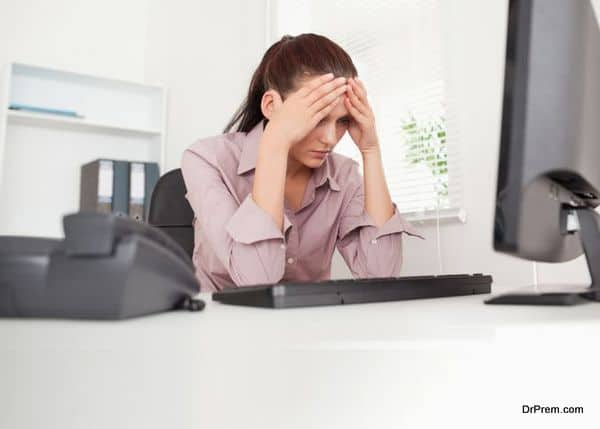 Frustrated businesswoman in office