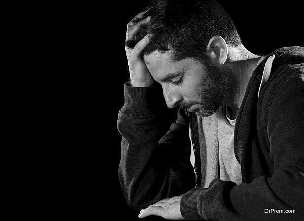desperate man suffering emotional pain, grief and deep depressio