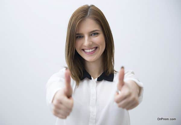 Portrait of a happy woman showing thumbs up