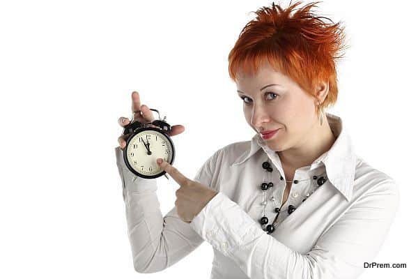 cheerful business woman with clock. Planning and organization co