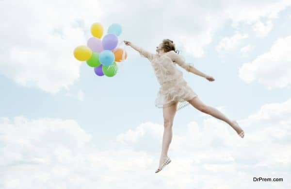 Magic lovely girl flying with Balloons