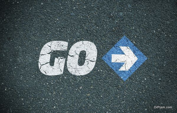 Road surface with the word go and an arrow sign