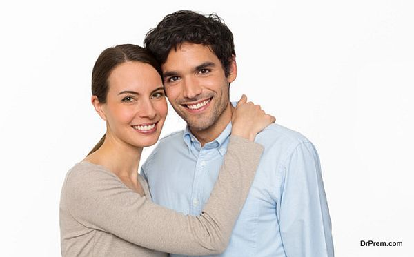 Happy young lover couple standing on white background, isolated
