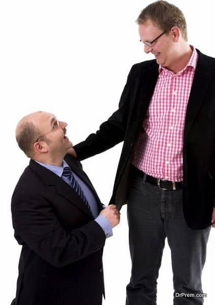 Two businessman standing next to eachother on white background