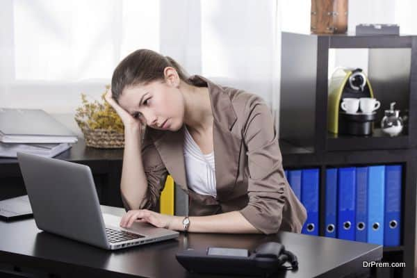 Elegant stressful business woman work on the notebook in the office.