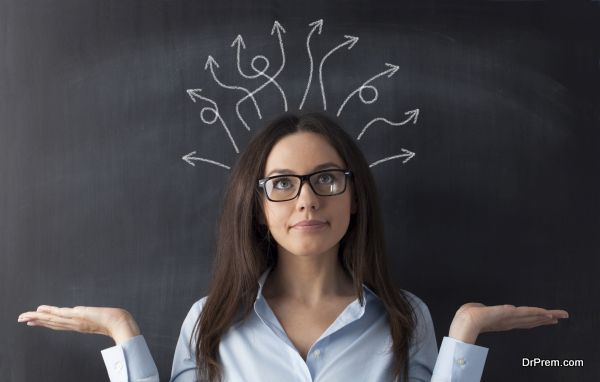 Businesswoman on blackboard and many twisted arrows in her head