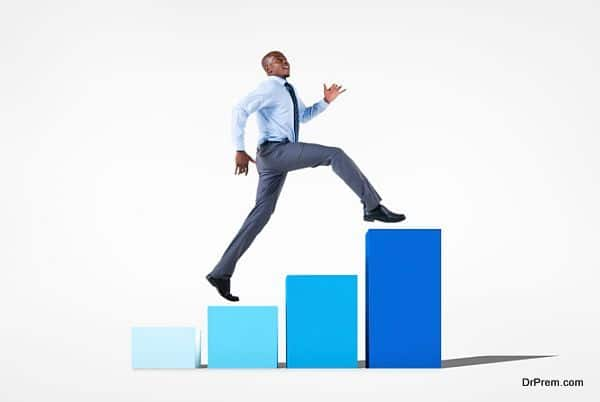 Businessman Jumping on a Developing Graph