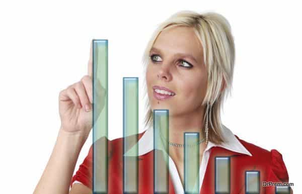 Beautiful businesswoman with bar chart