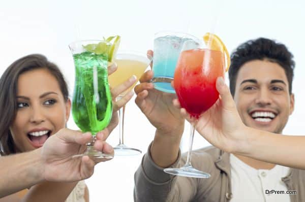 Group Of Happy Smiling Friends Celebrating Toasting With Glasses Of Juice
