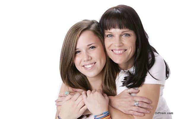Real People: Smiling Caucasian Mother Daughter Hugging Head Shou