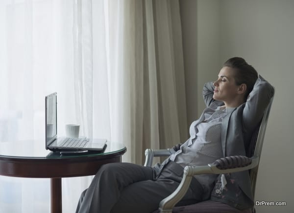 Relaxed business woman in hotel room
