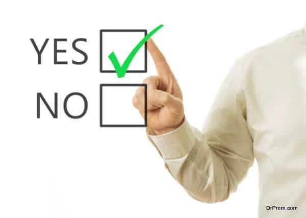 businessman hand and checkbox with green mark checking yes