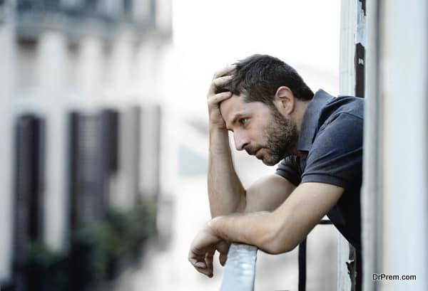 young man at balcony in depression suffering emotional crisis a