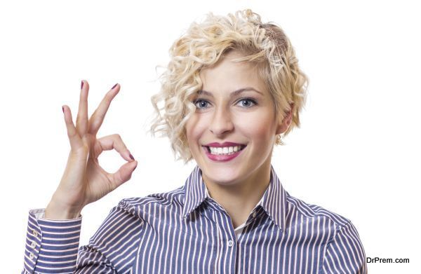 Happy smile woman gesturing ok - good, isolated on white background