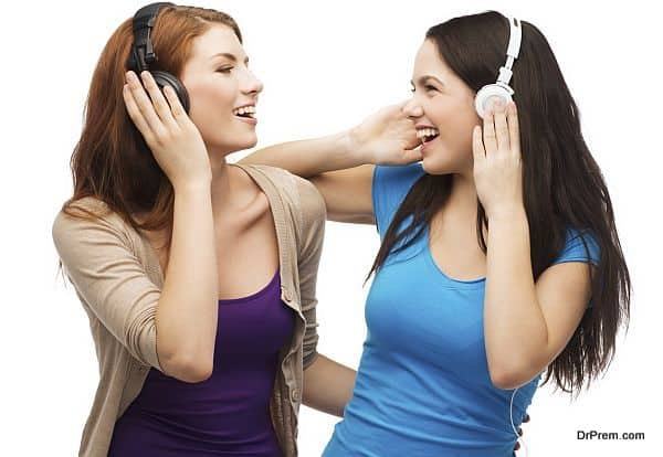 two laughing girls with headphones
