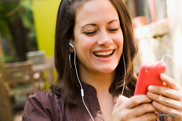 Woman listening to music on a mobile phone