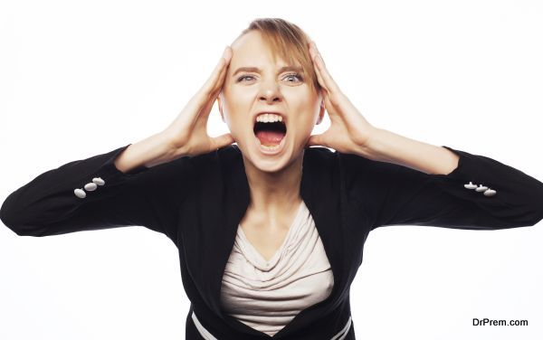 Stress and fatigue: angry screaming businesswoman. Isolated on white.
