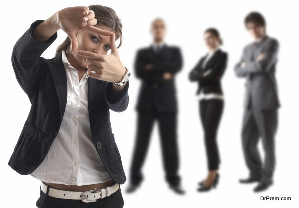 The goal - Young attractive business people - businesswoman in focus
