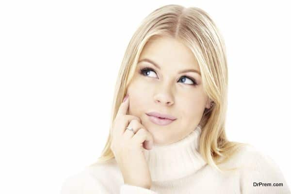 Portrait of the thoughtful blonde isolated on a white background