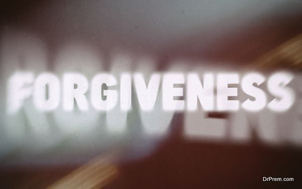 Forgiveness word on vintage blurred background, concept sign