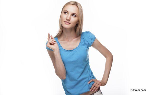 Beautiful teenage girl is thinking. Isolated on white background