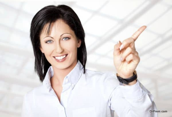 Portrait of beautiful woman smiling and pointing right direction