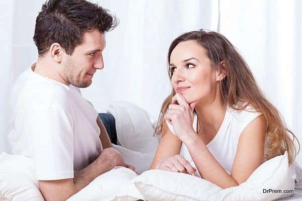 Couple contemplating in bed