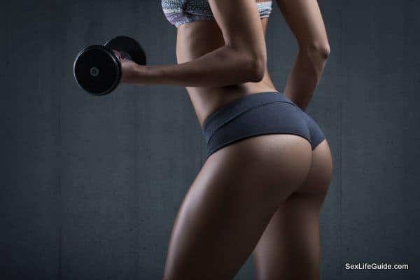 Very sexy young beautiful ass in thong. Fitness woman with dumbbells.