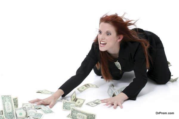 Crazed Business Woman Grabbing Money From Floor