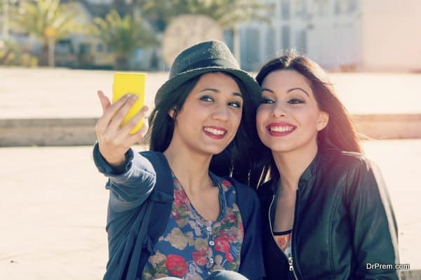 two friends taking selfie with a filter applied instagram style