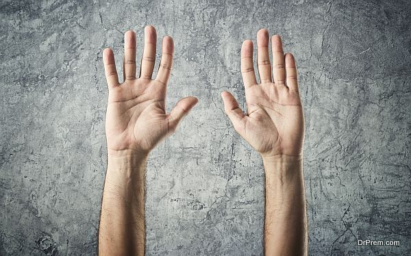 Caucasian male open hands raised as surrender gesture on grunge background