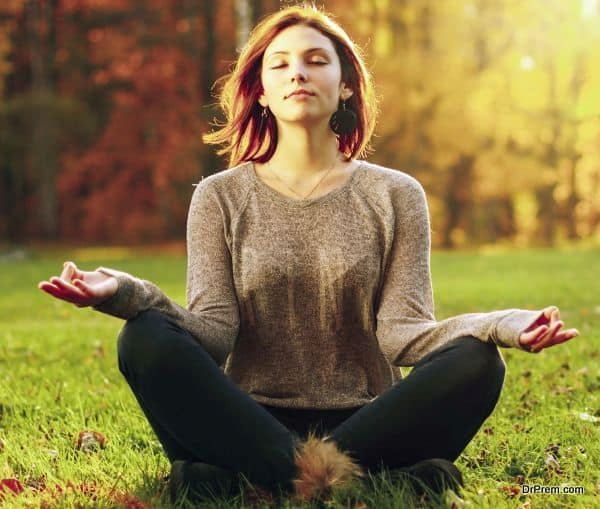 Beautiful young girl meditating