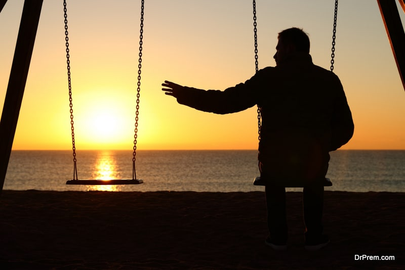 Man alone missing her partner at sunset