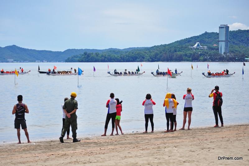 dragon boats racing during Sabah Dragon Boat Race in Kota Kinabalu, Sabah, Malaysia