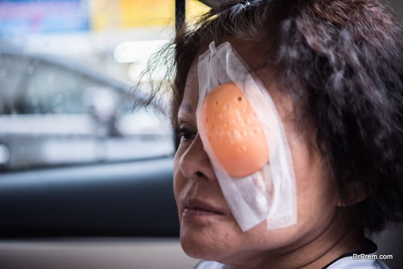 elder woman with eye shield after cornea surgery (lasik)