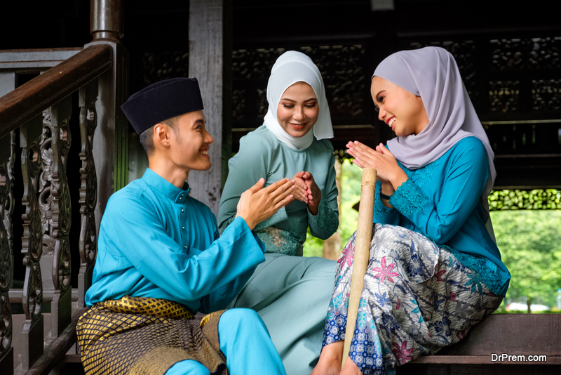 group of three malay people in traditional costume