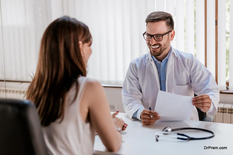 woman consulting family doctor