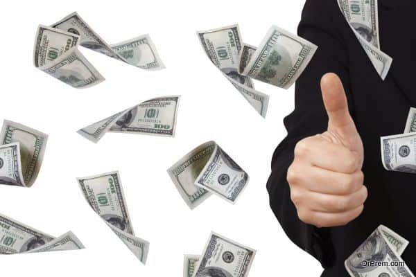 One hundred dollar money banknotes flying and falling down with confirmation sign of young business woman, isolated on white background.
