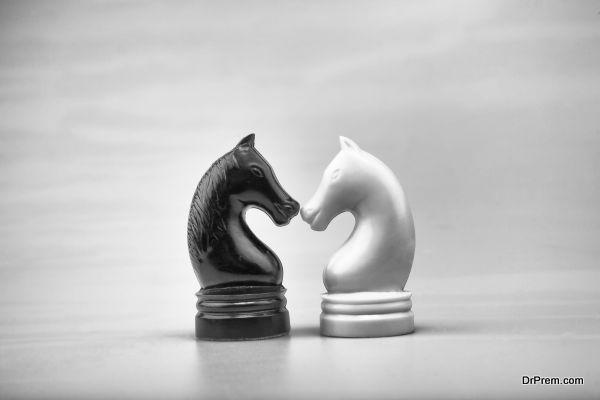 Chessmen of horses white and black.