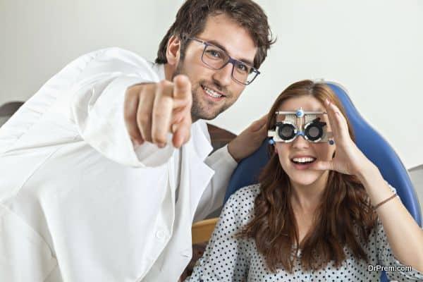 Optometrist Giving Young Woman An Eye Examination