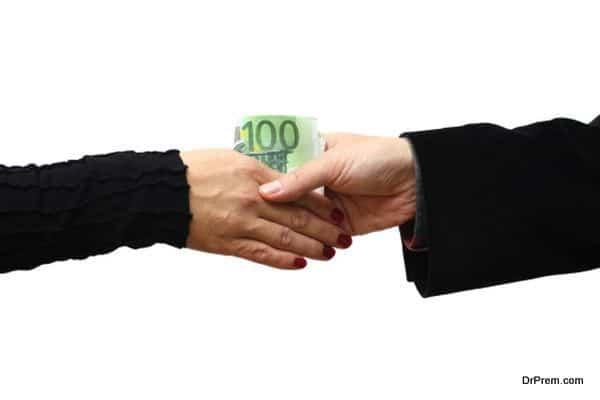 Handshake with money isolated on white background