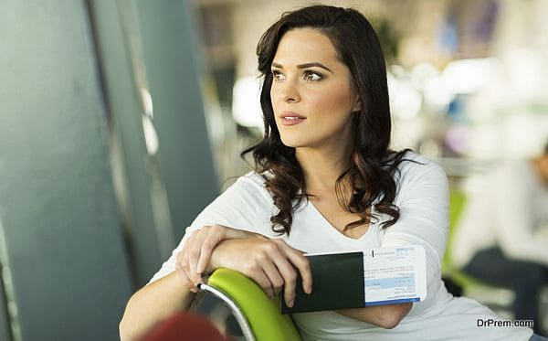 pretty woman waiting for her flight at airport