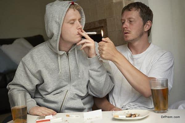 Man smoking marijuana with friend